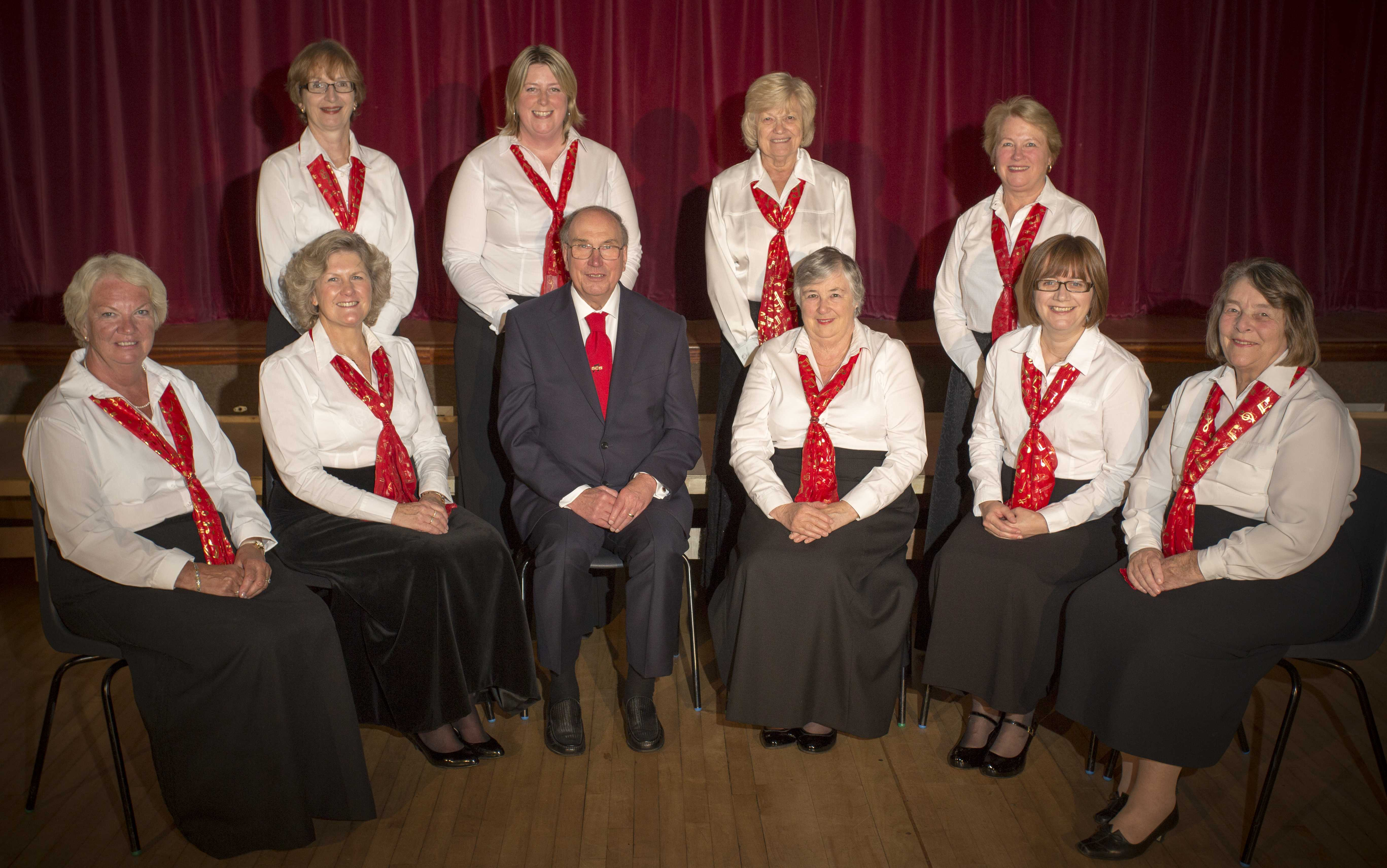 Left to right Front row: Julia Haines (membership secretary), Helen Pearce (secretary), Terry Pearce (musical director), Caroline Miller (chairman), Frances Brightman (treasurer) and Mo Hunt (librarian Back row: Joyce Huddleston (website manager), Abby Evans (publicity), Trish Napper (publicity) and Lindsey Fellingham (librarian)