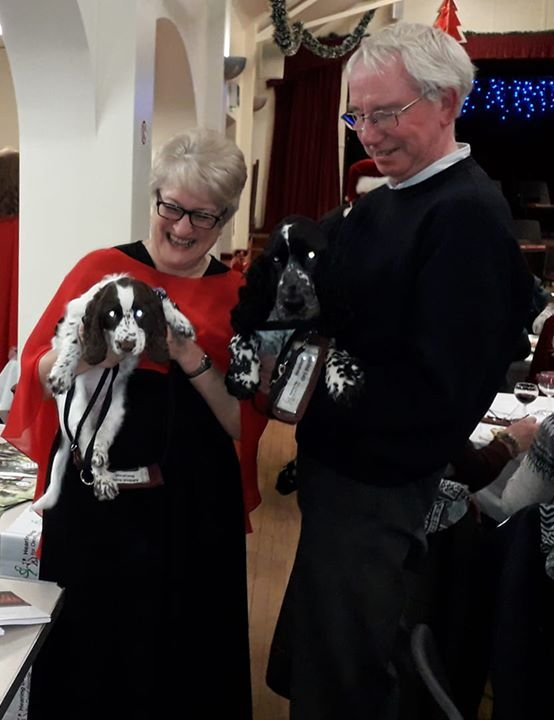 Riley and Troy, with their trainers, at the Steventon Choral Society Christmas Concert on 14 December 2019