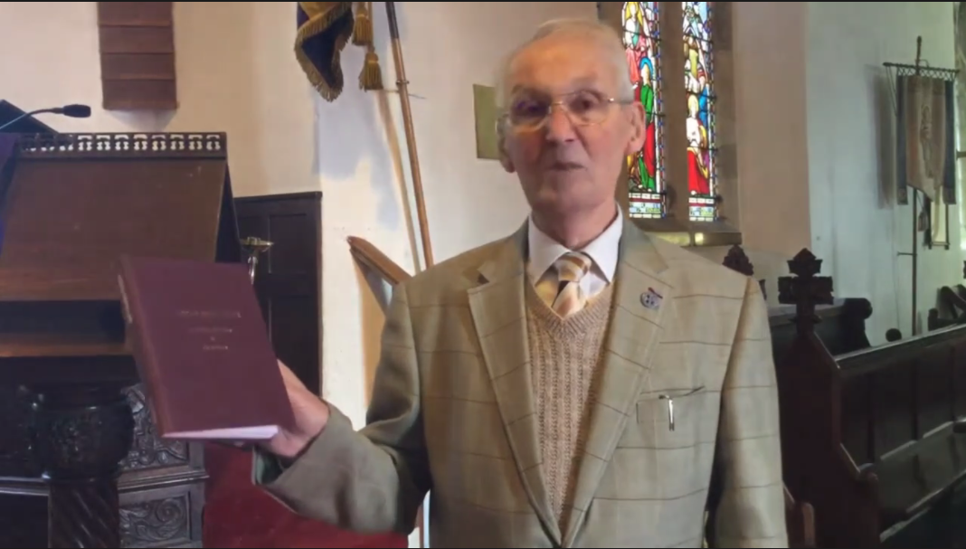 Jack Jarvis prepares to read two poems from the book of peotry by Arthur Baylis